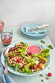 Grilled hallumi salad with little gem lettuce, raspberry dressing, fresh raspberries, hazelnuts and verbena mint