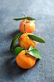 Mandarins on a stone surface, close up
