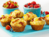 Savory muffins with scrambled eggs, maple syrup and bacon