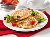 Pancakes with fruit and maple syrup