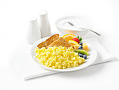 Scrambled eggs with fruit, toast and yoghurt