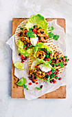 Spicy prawn tacos with bean salad