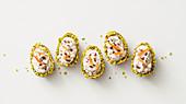 Chocolate eggs with mascarpone cream and pistachios