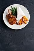 Orange-glazed pork with italian sweet potato chips