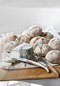 Homemade rye bread rolls served with goat's cheese