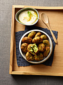 Zucchini balls with garlic mayonnaise