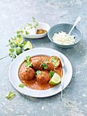 Zucchini and paneer koftas in chili tomato sauce