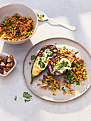 Grilled aubergine with red lentils, yoghurt and pesto