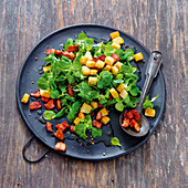 Corn salad with bacon and croutons