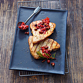 Grilled tuna steaks with caper and olive sauce