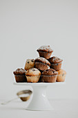 Mini muffins with chocolate drops on a cake stand