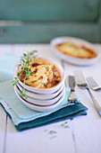 Celeriac gratin with tomatoes and cream