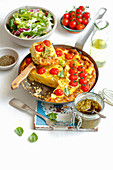 Potato tortilla with cherry tomatoes and pesto