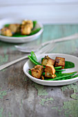 Diced miso tofu with mange tout
