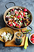Oven-baked beetroot with radishes, feta cheese and walnuts