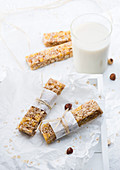 Sugar-free, vegan oat and nut bars served with a glass of oat milk