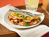Shrimp omelette with peppers and spring onions