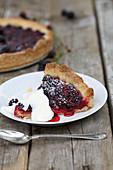 Blackberry tart with whipped cream