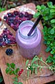 Blackberry milkshake in a glass