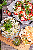 Potato salad, couscous with strawberries and grilled flatbread