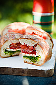 Sandwich cake with chicken, bacon and tomato