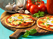 Margarita pizzas with egg