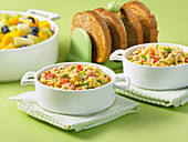 Couscous with scrambled eggs and vegetables for breakfast