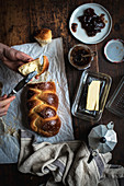 Challah bread (Jewish cuisine) with butter and jam on a breakfast table