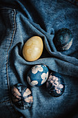 Easter eggs dyed with natural colours and decorated with flowers