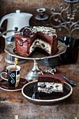 Chocolate cake with baked Oreo cheesecake and oreo cream