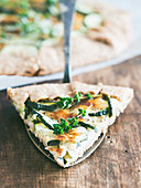 Savory zucchini and cheese galette on spelt dought, served with fresh thyme