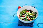 Rocket salad with strawberries, blackberries and feta cheese