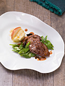 Ostrich steak with pear and potato puree and beans