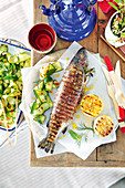 Prosciutto-wrapped trout with cured zucchini salad