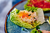 Rillette with fish and caviar in a lettuce leaf