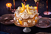 Frozen Vacherin cake with spiced biscuits, meringue and mango (Christmas)