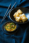 Steamed filo pastry parcels with a soya dip