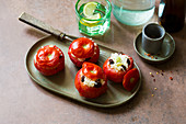 Steamed tomatoes filled with feta cheese and rice