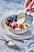 Breakfast Bowl with yoghurt, fresh fruits and pecans