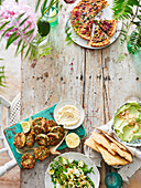 Crab herb cakes with mayonnaise, pasta salad with peas, avocado almond dip and Sorrel tart