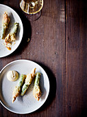 Fried and zucchini flowers stuffed with almond puree and Aioli