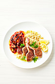Lamb cutlets with eggplant relish and pearl couscous