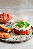 Beef tartare with cream cheese and chives