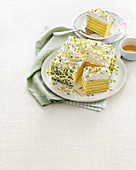 Lemon cake with cream and pistachios