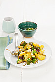 Courgette and potatoes with spring onions and caperfruits