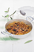 Spaghetti frittata with anchovies, olives and pine nuts