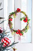 Christmas door wreath with red anemone flowers