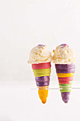 Rainbow waffle cones with vanilla ice cream