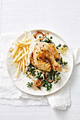Grilled chicken with kale gratin and french fries