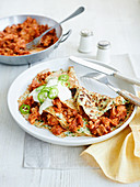 Pancakes with pulled pork, chillies and sour cream